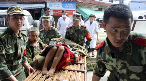 Rescuers carry a survivor after a major earthquake hit Yingjiang County, southwest China's Yunnan Province. (AP)