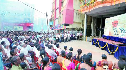 People watch the live telecast of Prime Minister Narendra Modi's swearing-in ceremony at the BJP office in Mangalore. (Source: PTI)