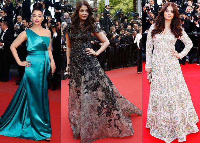 <b>Cannes 2013:</b> (L-R) Aishwarya Rai Bachchan wooed one and all on Day 1 of the prestigious Cannes Film Festival. She wowed the fashion police in her one-shoulder teal Gucci Premiere gown at the premiere of Behind the Candelabra. <br /> Next, she was a hit in her black and grey Elie Saab couture gown at the premiere of Inside Llewyn Davis. And finally in Abu Jani Sandeep Khosla floor-length anarkali with colourful heavy embroidery for the premiere of Blood Ties. (AP/Reuters)