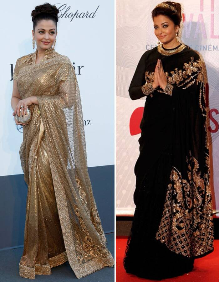 <b>Cannes 2013:</b> While Aishwarya rocked the gowns and other coutures at Cannes, she disappointed with her choice of ethnic outfits. (L)Aishwarya opted for a black lehenga-sari with golden embroidery by Sabyasachi for the evening gala of 'Bombay Talkies' celebrating 100 years of Indian cinema with matching golden hair accessory. (R) Aishwarya Rai's golden sari by Tarun Tahiliani for amfAR's Cinema Against AIDS 2013 was the worst dress at the Cannes red carpet. (Reuters)