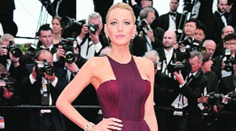The actor wore a Gucci Première two-tone bordeaux silk chiffon, fully-pleated evening gown featuring a geometric neckline.