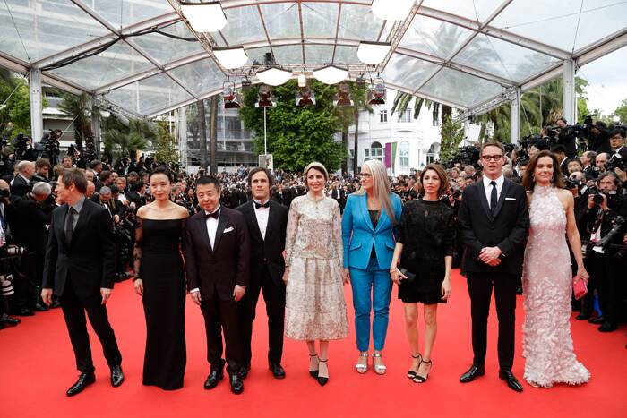 Cannes Jury Members: Willem Dafoe, Jeon Do-yeon, Jia Zhangke, Gael Garcia Bernal, Leila Hatami, jury president Jane Campion, Sofia Coppola,Nicolas Winding Refn and Carole Bouquet pose together before the opening ceremony of the 67th Cannes Film Festival and screening of the 'Grace of Monaco'. (Source: AP)