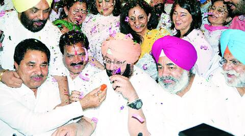 A local Congress leader offers a sweet to Captain Amarinder Singh after he won from Amritsar on Friday. RANA SIRAJIT SINGH