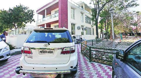 A car parked in front of former MP Balwant Singh Ramoowalia's Sector 63 residence in Mohali on Saturday.  ( Source: Express photo by Jasbir Malhi )
