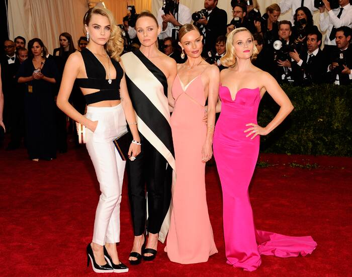 Model Cara Delevingne shrugged off the whole theme of a gown, looking smooth in a cropped top with white pants. <br />Designer Stella McCartney picked monochrome for the night, while Kate Bosworth and Reese Witherspoon opted for rosey-hued Stella McCartney numbers.  (AP)