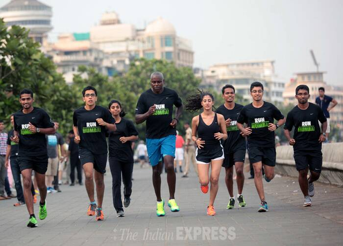 Olympic legend and athlete Carl Lewis participated in running along with young Mumbaikers at the Marine Drive on Monday (May 19). (Source: Express photo by Kevin Dsouza)