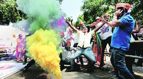BJP workers celebrate in the capital. ( Source photo by Ravi Kanojia )