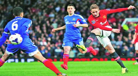 debut double: James Wilson, 18, scores his first senior goal for United in their last home game of the season.Reuters