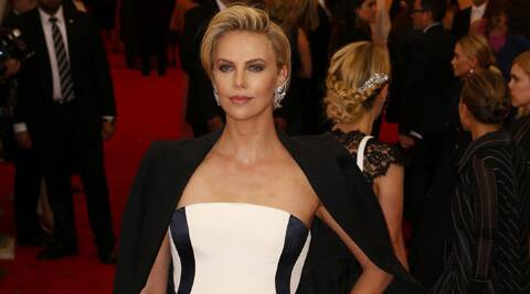 Charlize Theron is in talks to produce and star in indie drama 'American Express'.
