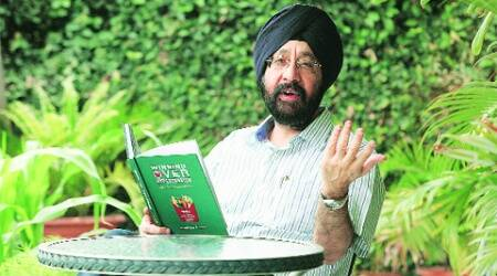 Dr Sarvinder Gandhok with his book in Chandigarh on Tuesday. (Jasbir Malhi)
