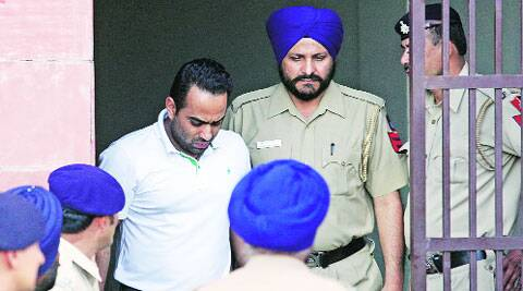 The accused at district courts in Sector 43, Chandigarh, on Tuesday. ( Express photo by Jasbir Malhi )