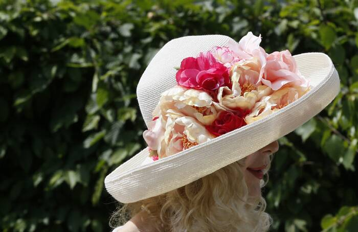 A woman wears a flower-decorated hat at the Chelsea Flower Show. (Source: Reuters)