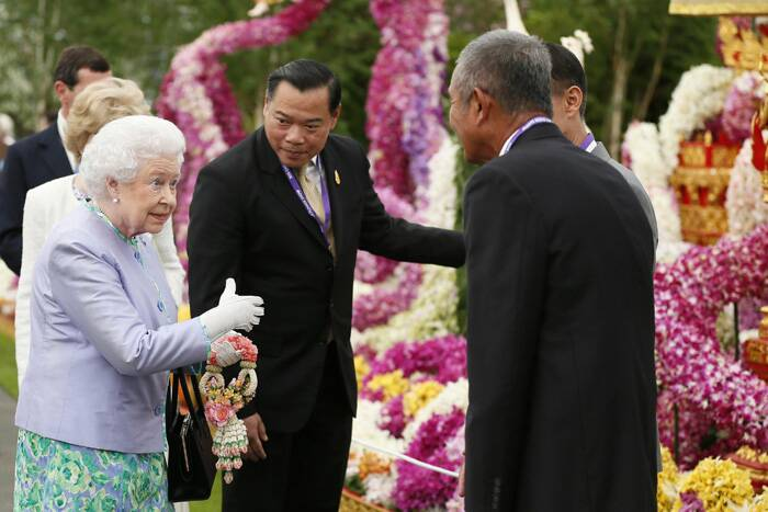 Britain's Queen Elizabeth II visits the Thai exhibit during a visit to the Chelsea Flower Show. (Source: AP)