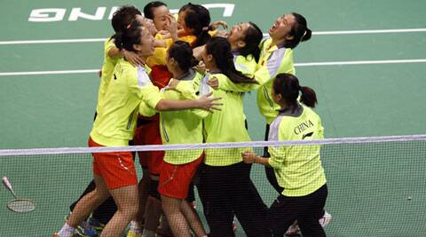 China's team members get into a huddle to celebrate their win over Japan in the final match of the Uber Cup in New Delhi on Saturday. ( Source: Reuters )