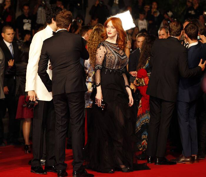 Actress Christina Hendricks opted to wear a sheer black creation by Italian designer Alberta Ferretti for her red carpet appearance. (Source: AP)