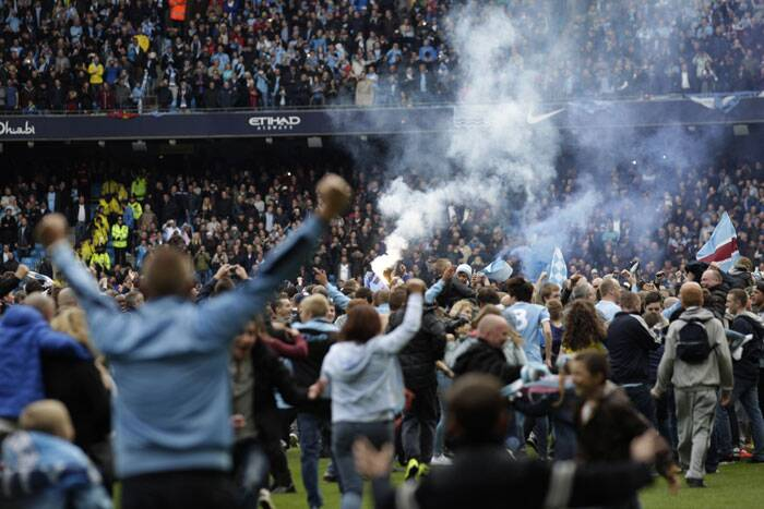 The fans invaded the pitch after City won their second EPL title, in three years (AP)