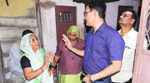 An official of the Gautam Buddh Nagar district administration speaks to a Dalit family in Kanawani village. Gajendra Yadav)