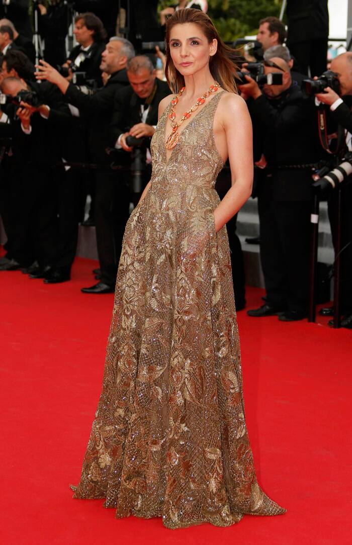 Princess Clotilde Courau of Savoy and Venice, who is also a French actress picked a stunning gold Valentino lace gown for her turn on the red carpet as she arrived for 'The Search'. (Source: Reuters)