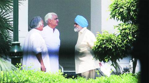 Salman Khurshid, Jairam Ramesh, Montek Singh Ahluwalia after the last Cabinet meeting.