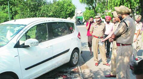 Police inspect the car in Sector 69 in Mohali on Wednesday. ( Source: Express photo by Jasbir Malhi )