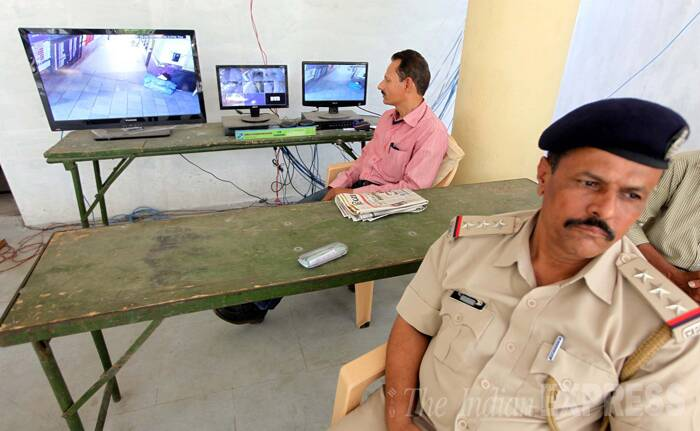 Security personnel keep a watch on the room and the counting area inside the counting station in Vadodara on Thursday. (Source: Express Photo by Bhupendra Rana)