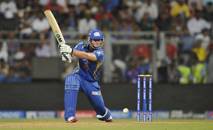 Mumbai Indians all-rounder Corey Anderson, who had a disappointing outing in the UAE leg of the ongoing Pepsi IPL tournament, was finally among the runs in the team's first home tie in Mumbai. He scored a quickfire 35 off 25 deliveries and chipped in with the wicket of Kings XI Punjab opener Cheteshwar Pujara. (IE Photo Prashant Nadkar)