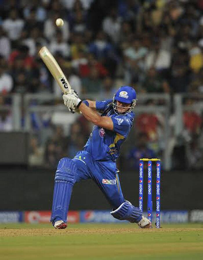 Mumbai Indians all-rounder Corey Anderson plays a swashbuckling drive during their match against Kings XI Punjab in Mumbai. He had a good outing in his first home tie with the Mumbai Indians. (IE Photo Prashant Nadkar)