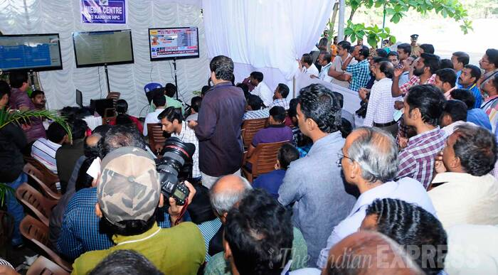 People watching live results outside a counting centre in Kannur. (Source: IE Photo by S K Mohan)