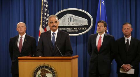 Attorney General Eric Holder speaks at a news conference at the Justice Department in Washington, Monday. (AP)
