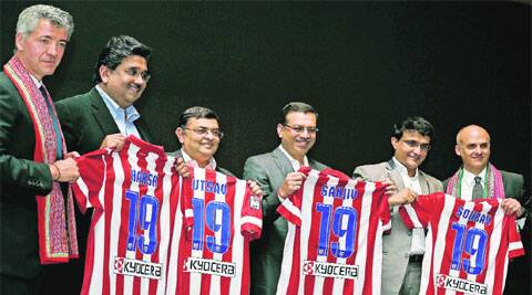 Atletico owner Miguel Angel Gil Marin (left) presenting his club jersey to co-owners of Kolkata franchise, including Sourav Ganguly. PTI