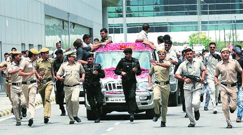 Security personnel escort Modi's vehicle on his arrival at IGI Airport in New Delhi on Saturday. Ravi Kanojia