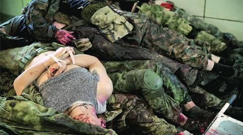 Bodies of pro-Russian gunmen killed in clashes at the airport piled up at a morgue in Donetsk. ( Source: Reuters )