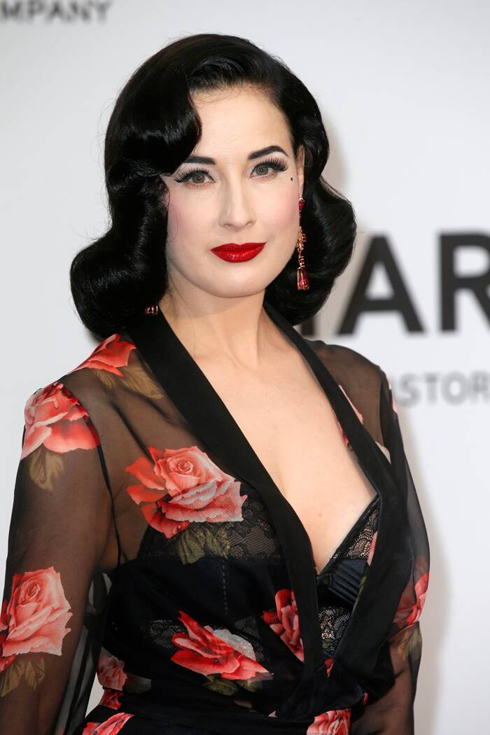 Burlesque dancer and model Dita Von Teese was gorgeous in a rose-printed Bluemarine dress with Chopard jewels.  (Source: Reuters)