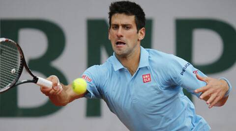 Novak Djokovic returns the ball during the third round match of the French Open against Croatia's Marin Cilic. (Source: AP)