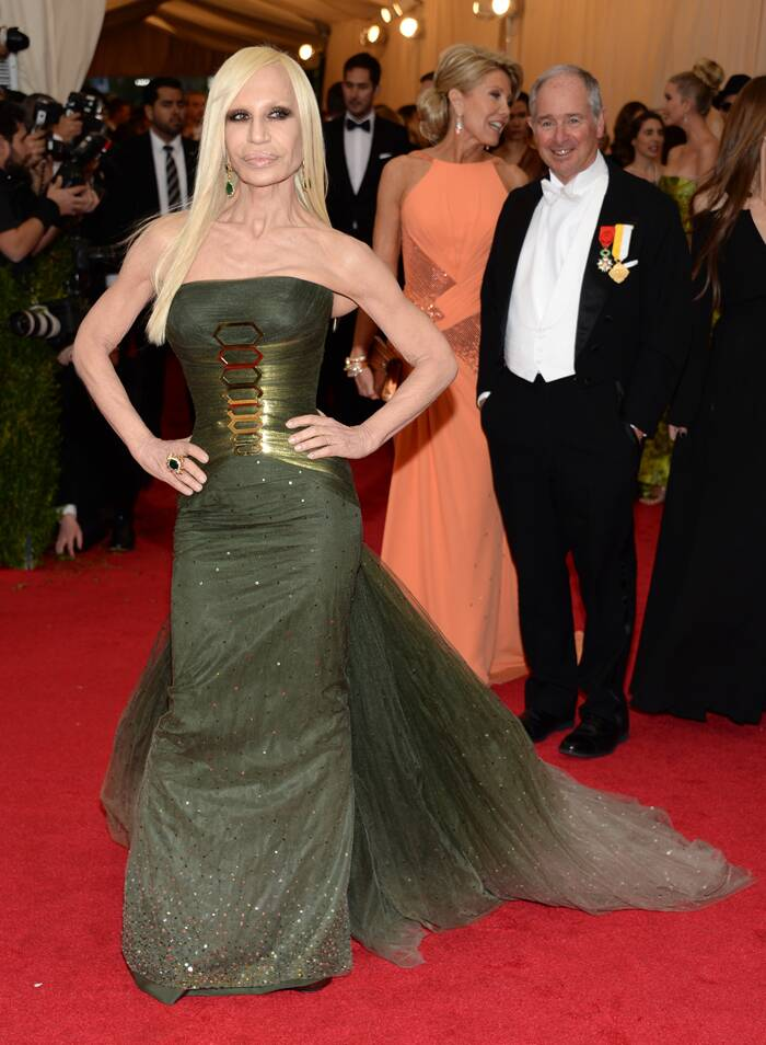 Designer Donatella Versace wore her own gorgeous bottle green design. (AP)