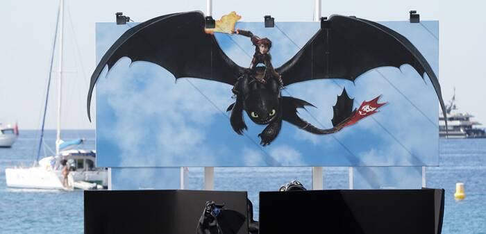 Here's a glimpse of a giant puppet of the dragon Toothless, from 'How to Train Your Dragon 2', which was suspended behind a barrier on a beach pier at the 67th international film festival, Cannes. (Source: AP)
