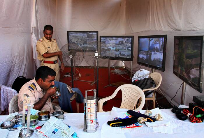 Tight security is in place for the counting of 16th Lok Sabha Polls. <br /><br /> Security personnel are seen having lunch in the makeshift CCTV room at NESCO complex ground in Goregaon, Mumbai where counting of votes for the Lok Sabha elections 2014 will take place on Friday (May 16). (Source: Express Photo by Amit Chakravarty)