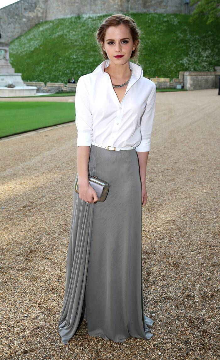 'Harry Potter' star Emma Watson was chic in a collared white shirt with a grey flowy skirt and metallic clutch. ( Source: Reuters )