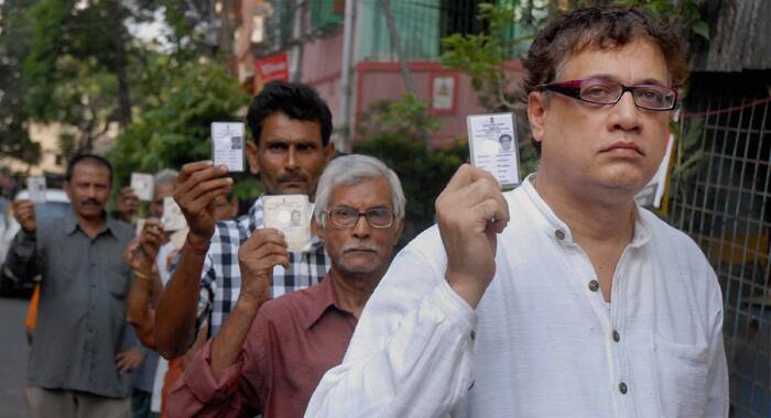 Trinamool Congress Rajya Sabha MP and party leader Derek O'Brian shows stands in a queue to casting vote for the last phase of Lok Sabha election, in Kolkata on Monday. (PTI)