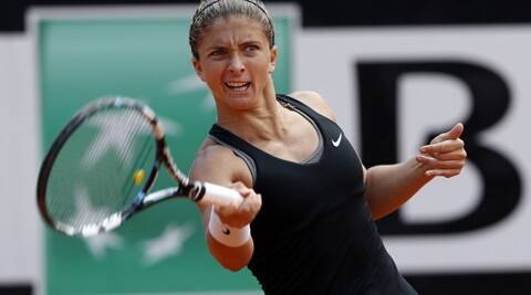 Sara Errani of Italy hits a return to Jelena Jankovic of Serbia during their women's singles semi-final match  at the Italian Open on Saturday. (Reuters)
