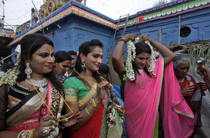 Eunuchs show their holy strings after the marriage ceremony during the annual eunuch festival. (AP)