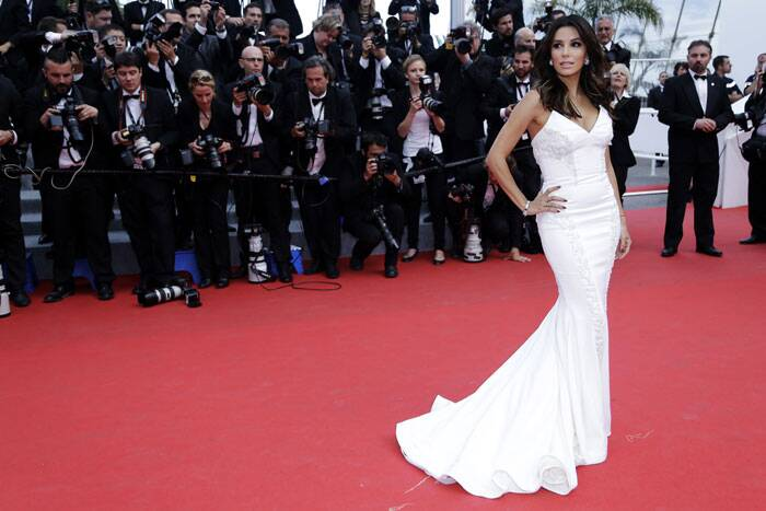 Actress Eva Longoria poses on the red carpet as she arrives for the screening of the film 'Saint Laurent' in competition at the 67th Cannes Film Festival in Cannes. (Source: AP)