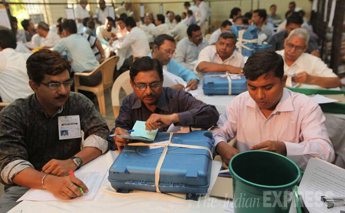 Counting officers in Vadodara get ready to count ballots on Friday morning. (Source: Express Photo by Bhupendra Rana)