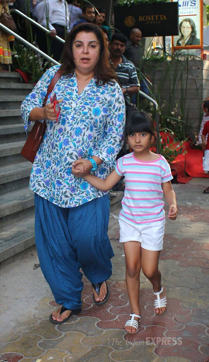 The choreographer-turned-director was dressed in a blue while her daughter wore shorts and a tee shirt. Seen here with her daughter.  (Source: Varinder Chawla)