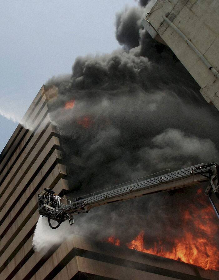 The fire which broke out on the fourth floor of the commercial building at around 10 am in the morning, soon after the complex opened for the day. (Source: PTI)