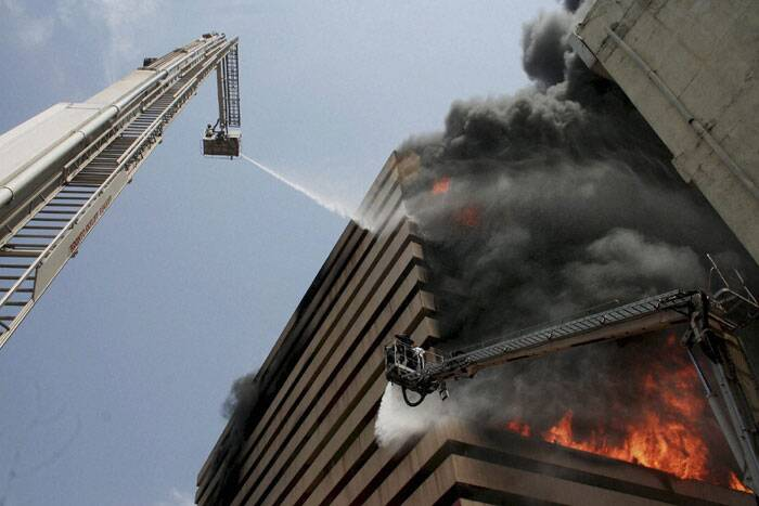 A fire broke out in a commercial multi-storey building in Surat on Thursday (May 29). The building, Orchit tower, situated on Puna Kumbharia road housed a saree market. (Source: PTI)