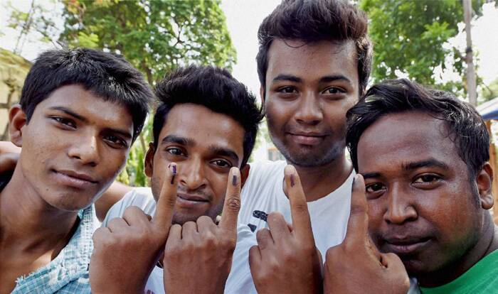 First time voters showing the ink marks after casting their votes for the Lok Sabha elections in Kolkata. ( Source: PTI )