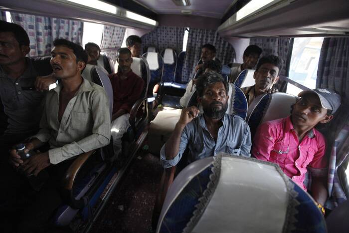 Fishermen from India sit in a bus after their release. (Source: Reuters)
