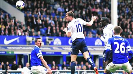 Edin Dzeko scores Manchester City's second goal against Everton at Goodison Park on Saturday. (AP)
