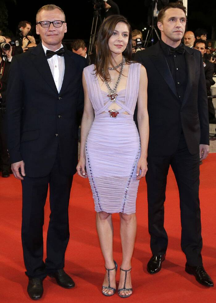 Alexei Serebryakov, Elena Lyadova and actor Vladimir Vdovichenkov pose for photographers as they arrive for the screening of 'Leviathan' at the 67th international film festival. (Source: AP)
